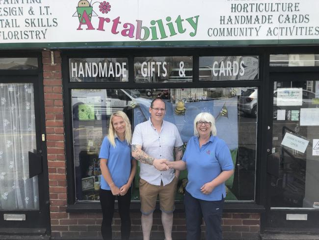 Community support after attack - Kaira Barnes, Iain Martin, owner of iCubed Home Cinema, and Artability owner Lynn Barnes