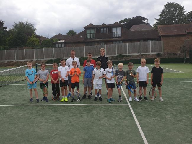 On court - the Year 4 boys group with Rayleigh Lawn Tennis Club's coaches on finals day