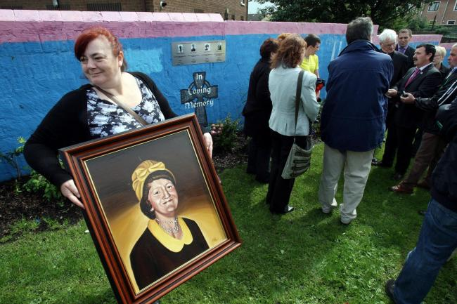 Irene Connolly with a portrait of her mother Joan, who was killed by the Army in Ballymurphy (PAul Faith/PA)
