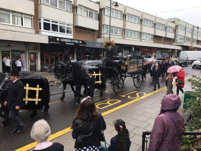 Tribute for John - the procession led by the horse drawn carriage through the town centre - procession picture by Nick Owens