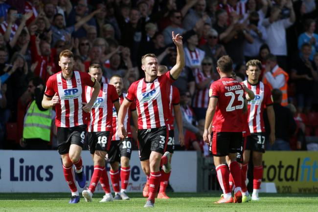 Doubling the lead - Harry Toffolo celebrates Lincoln City's second goal of the game