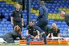 Worrying moment - Emile Acquah is treated by medical staff     Picture: NICKY HAYES