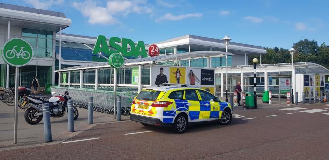 Scene - police on the scene yesterday after an attempted abduction at Asda in Colchester