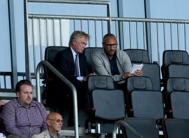In talks - Blues chairman Ron Martin with Henrik Larsson in the stands at Stadium MK