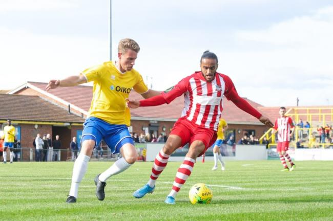 Set to lock horns again - Canvey Island's Elliott Warren and Bowers & Pitsea winger Quentin Monville Picture: NASH PHOTOGRAPHY