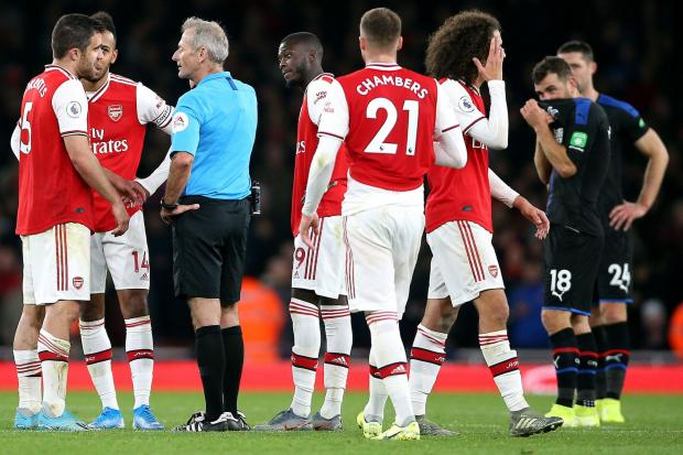 Referee Martin Atkinson gives the VAR decision of No Goal overturning the second goal by Arsenal's Sokratis Papastathopoulos during the Premier League match at the Emirates Stadium, London. PA Photo. Picture date: Sunday October 27, 2019. See PA stor