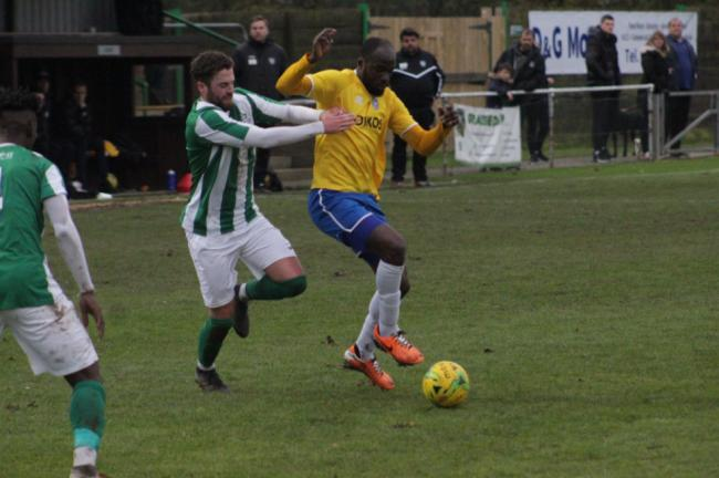 On the charge - Canvey Island's Tobi Joseph looks to break away from Great Wakering Rovers left-back Reece Conway Picture: ANDY WILKINS