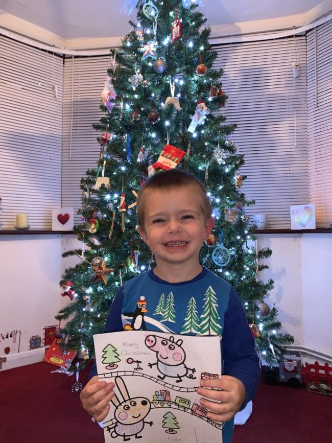 Working hard - Tyler has been busy colouring in Christmas cards to give out to those on the streets