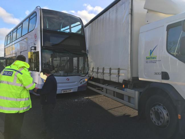 Bus and lorry crash blocks busy industrial estate road