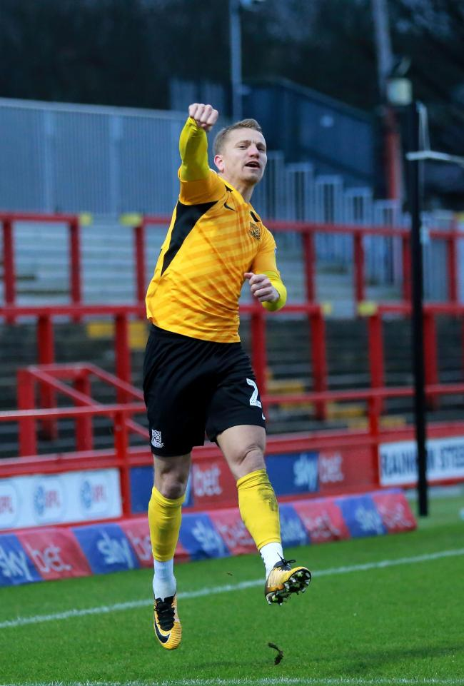 Jumping for joy - Jason Demetriou celebrates his penalty