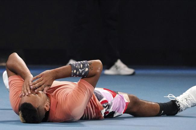 Nick Kyrgios lies down on the court after defeating Karen Khachanov