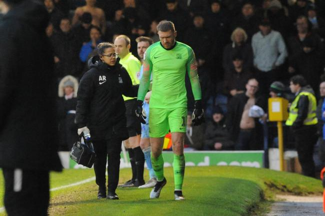 Injured - Mark Oxley limps off against Coventry City