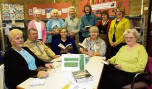 Library staff and users meet to mark the anniversary