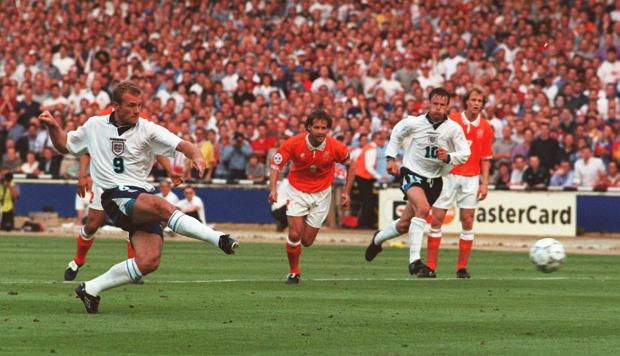 Echo: GOAL: Alan Shearer scores from a penalty to open the scoring for England in tonight's Euro 96 clash against Holland at Wembley. Picture: Neil Munns/PA