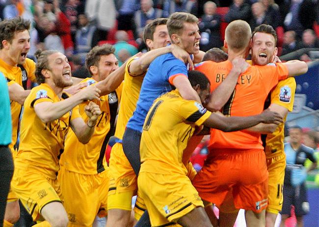 Get in - Southend United's players celebrate winning at Wembley