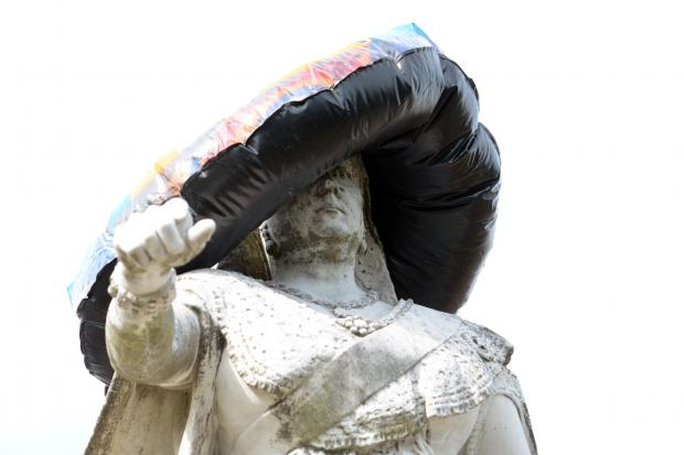 Echo: Not amused- someone puts a rubber ring over Queen Vic's head in 2014