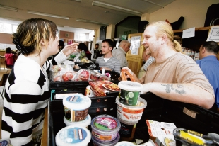 Sustenance for all – volunteer John Hailes and Leanne Richardson at the Storehouse project, giving out food last year