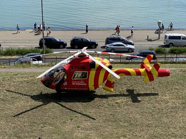 Air ambulance lands by seafront to treat medical emergency