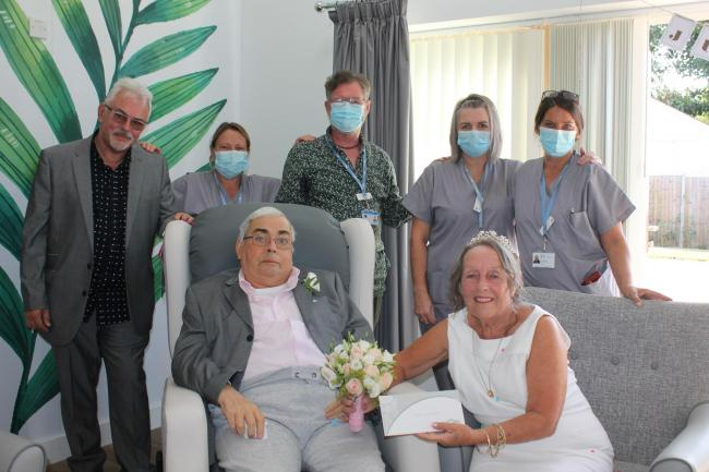 Ceremony - the happy couple with hospice staff