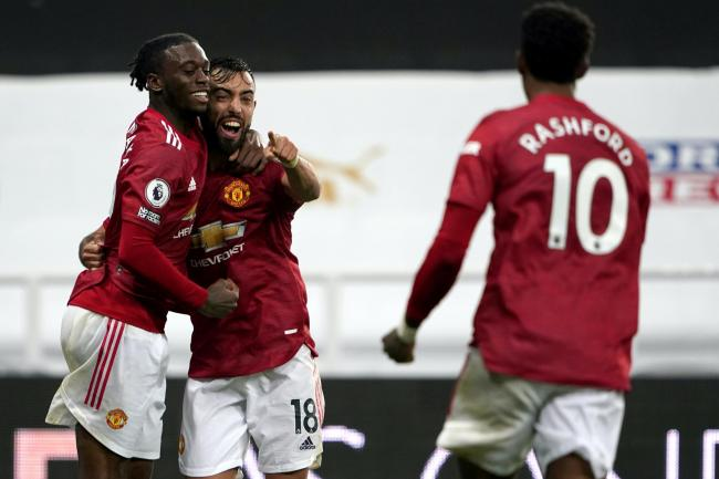 Bruno Fernandes, centre, missed a penalty before helping Manchester United to victory