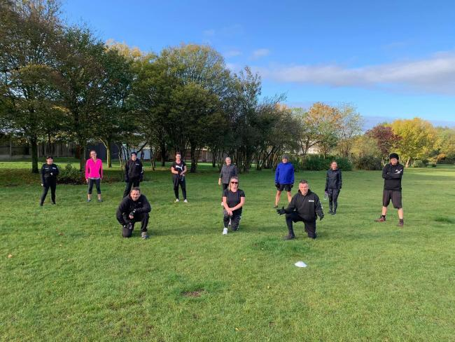 Following government guidelines - Motiv-8 Bootcamp & Fitness clients socially distanced during a session