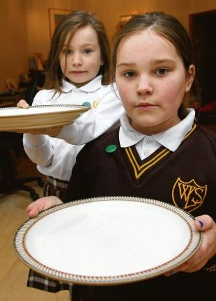 Molly and Emma Banks were told they will not be fed if they don't pay their school dinner money on time