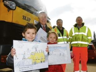 Winners – Harrison Essam and runner-up Bailee Gosling with gritter drivers Andy Day,   Jason Carroll  and county councillor Roger Walters