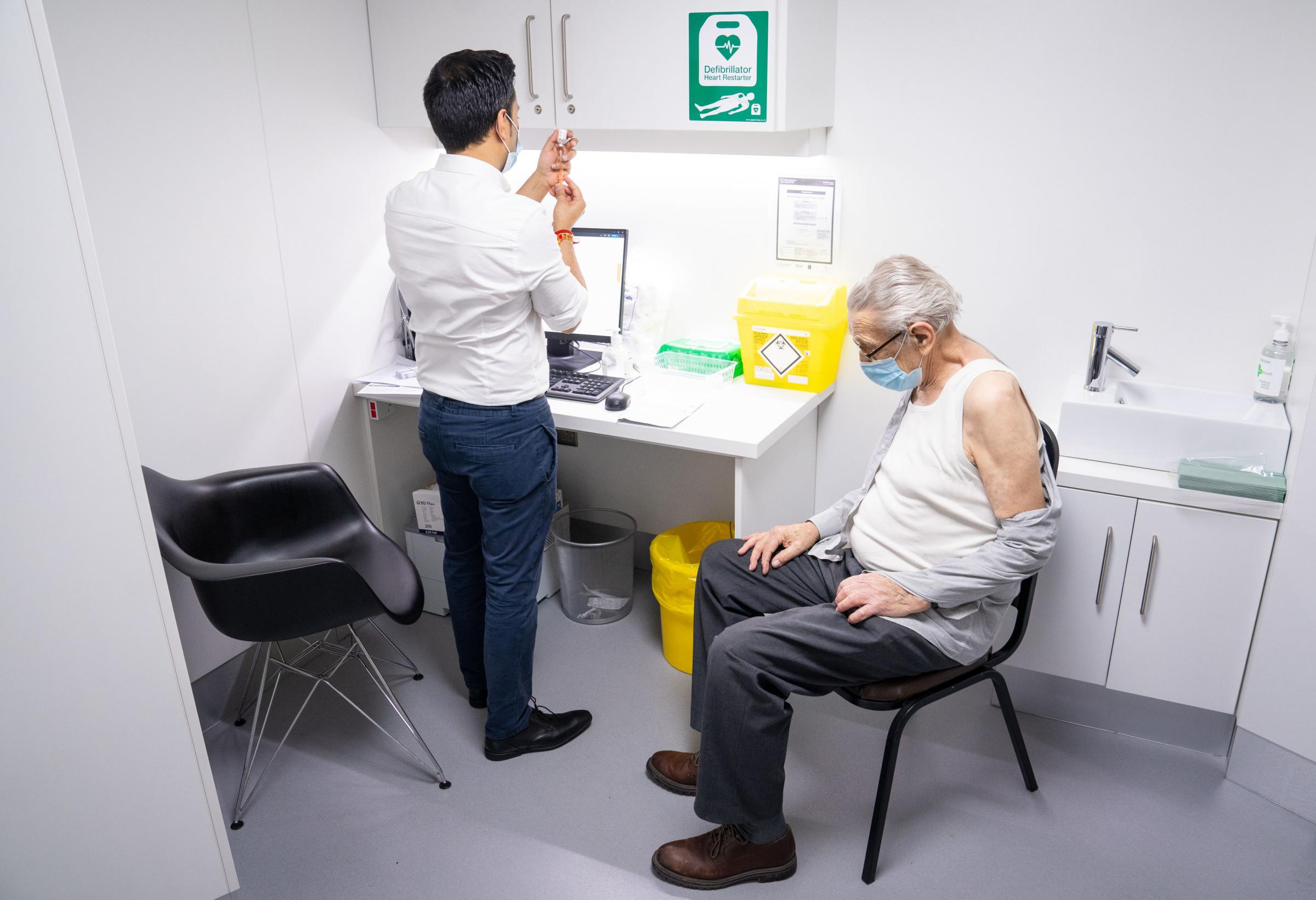 Pharmacist Bhaveen Patel prepares to give a dose of the Oxford / AstraZeneca covid vaccine to Brian Bourne at a coronavirus vaccination clinic held at Junction Pharmacy in Brixton, London. The roll out of the vaccination programme continues as the Governm