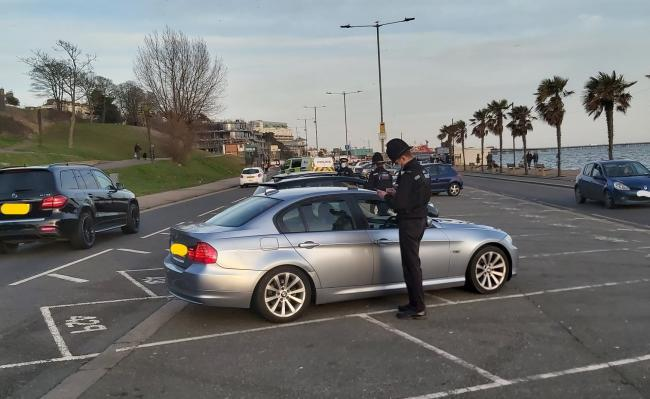 Officers speak to drivers who had flocked to Southend over the weekend. Picture: Southend Police