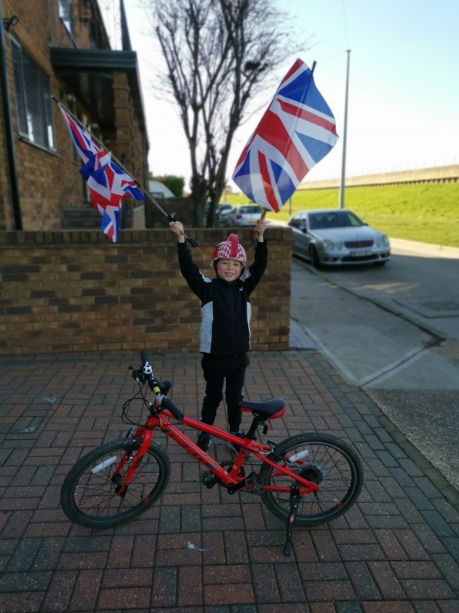 Flying the flag - the youngster has already set his sights on another bike-riding challenge