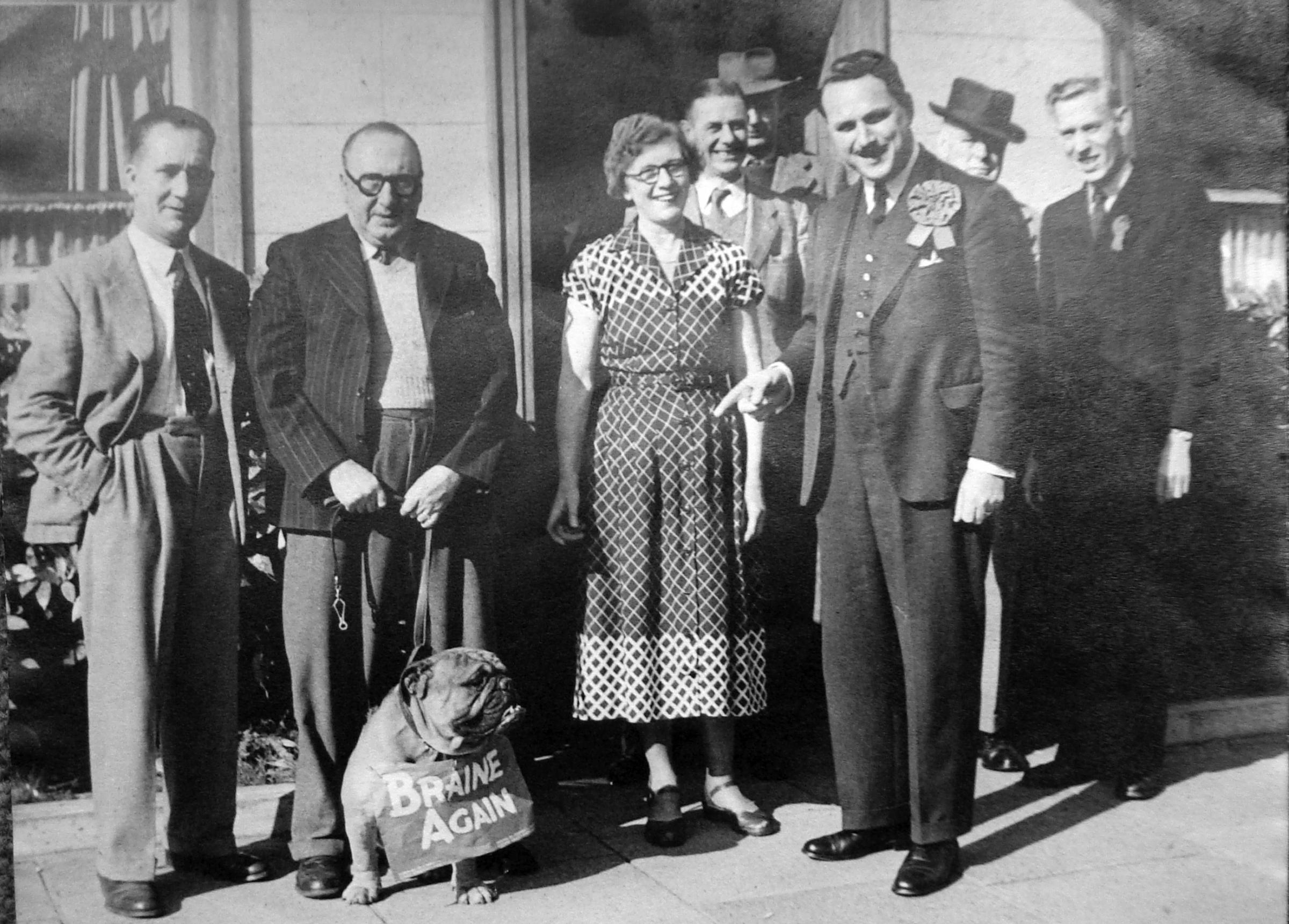 Together - Castle Point MP Sir Bernard Braine at the Red Lion with his bulldog mascot after the 1959 election