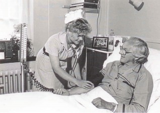 Bedside manner - a patient is seen to by a Southend Hospital nurse in the 1980s