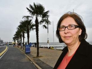 Continental feel - Southend councillor Anna Waite admires the first of 12 palms to go up on Southend seafront