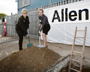 Burying the time capsule – Tracy Williams of Genesis Housing Group and Gail Newton from Logic Homes