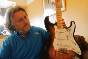 Up for sale on Ebay – Alan Jones shows off Ronnie Wood's guitar he is selling for £110,000, as a favour for a friend