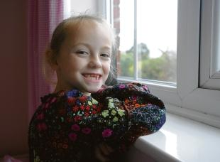 Daisy Palmer, seven, who suffers from a potentially-deadly stomach disorder