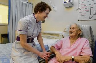 Kathy French, the deputy director of nursing, chats to patient Joyce Bruce
