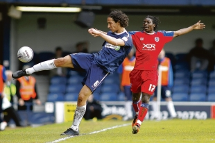 Bilel Mohsni - tries to keep the ball in play on his Blues return