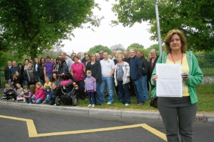 Not here – Laindon residents object to a legal travellers' camp opposite a primary school, councillor Jilly Hyde shows the