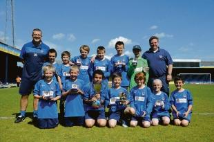 Pride — Forest Glade U11s show off their winners trophy for beating Concord Rangers