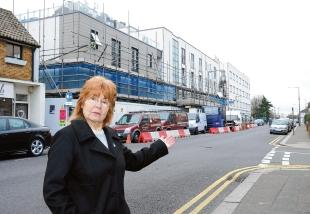 Parking problem – Leigh councillor Caroline Parker points to the vans in Rectory Grove