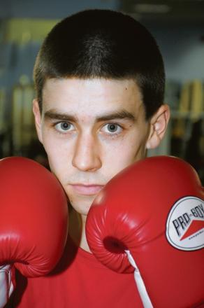 Basildon boxer Lewis Adams has defended the British Universities Championship crown he won last year.