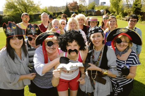 Fun fundraising – members of staff show off their wacky costumes