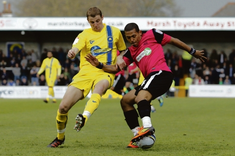 Ryan Hall battles for the ball at Torquay United
