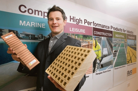 Stuart Burns, managing director of Dura Compostites, showing off some of their products