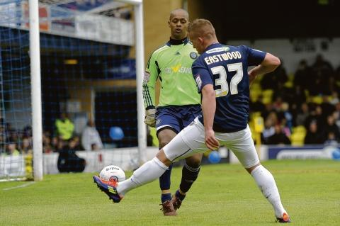 Freddy Eastwood closes down Macclesfield goalkeeper Jose Veiga
