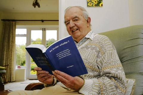 Life story – Reg Higgins in his Leigh home with his new autobiography