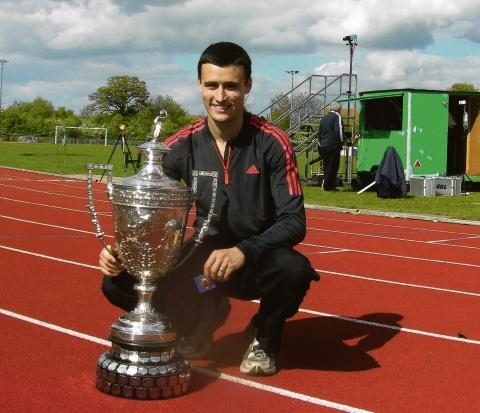 Adam Hickey with his trophy for winning the 5,000m at the Essex Championships