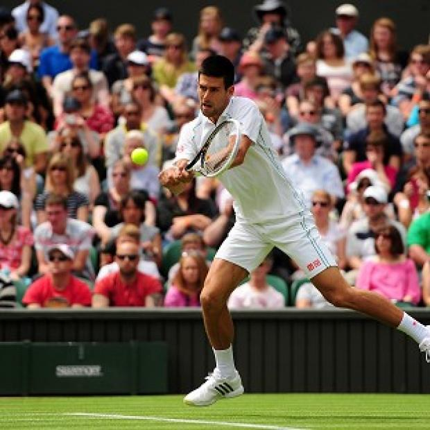 Novak Djokovic eases into the second round against Juan Carlos Ferrero