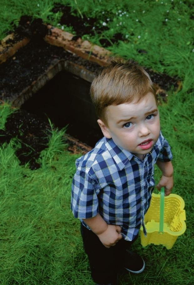 Shocked – Aaron at the hole he fell in  to